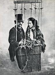 Nadar and his wife with a studio shot of hot air balloon (In 1856 he did actually go aloft in a balloon over Paris and took the world's first aerial photograph)